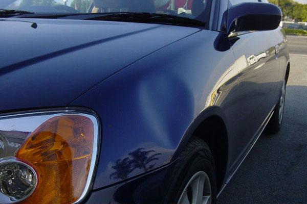 Как без покраски убрать вмятину на кузове автомобиля?